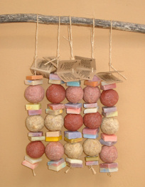 Soap Collars: a string of small offcuts of soap threaded on a roap.