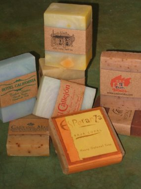 Soaps showing customized labels for various hotels that stock themin the guests rooms.